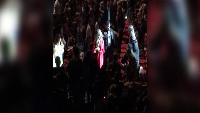 Delta Goodrem rushes to fainted fan during Sydney show