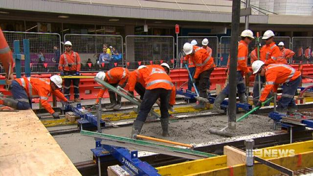 VIDEO: First Sydney CBD tram tracks laid
