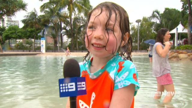 Wet weather does nothing to dampen the Christmas spirit in Queensland