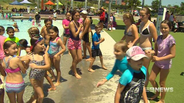 VIDEO: Temperature records tumble as Queenslanders try to cool off
