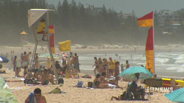Records tumble as Queensland swelters through heatwave