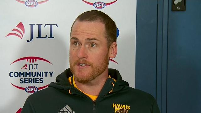 Roughead returns as Hawks beat Cats after siren