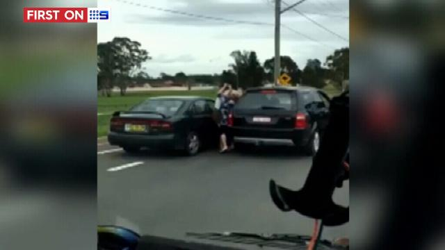 Two women captured on camera brawling during Sydney road rage fit