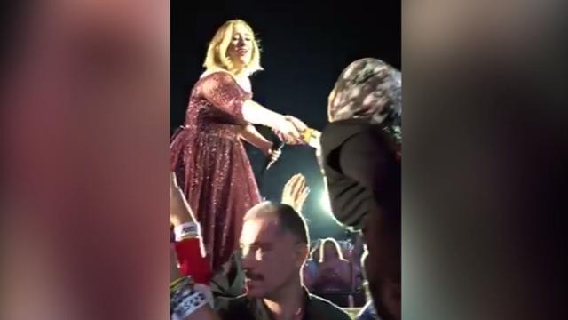 Adele kisses lucky fan during Sydney concert