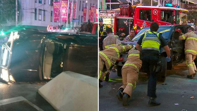 Car flips over on Bourke Street