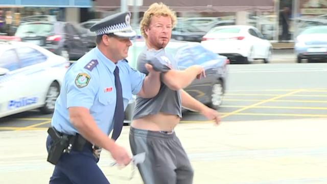 NSW cop arrests swearing man in middle of media conference