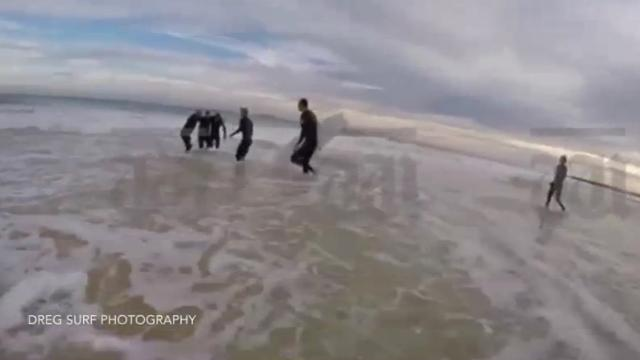 9RAW: Aussie surfers drag shark attack survivor from water
