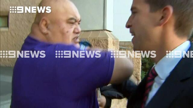 Bikie supporter lashes out at 9NEWS camera crew at court