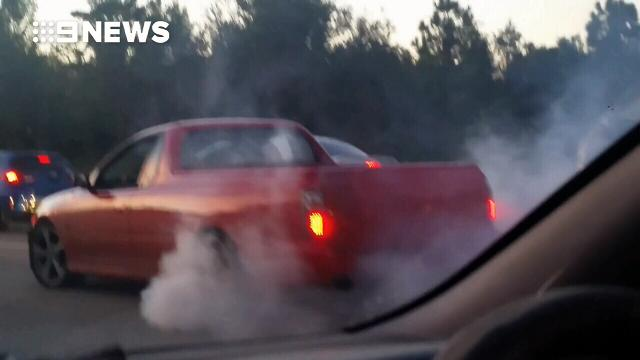 Driver does burnouts on the M1 while stuck in traffic