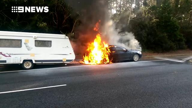 Motorist alerts elderly couple moments before their car explodes into flames