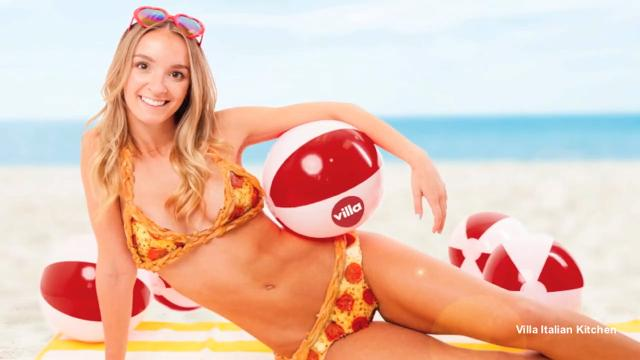 Model poses in real-life pizza-kini
