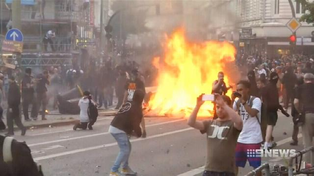 Protesters burn cars, throw petrol bombs as world leaders meet for G20