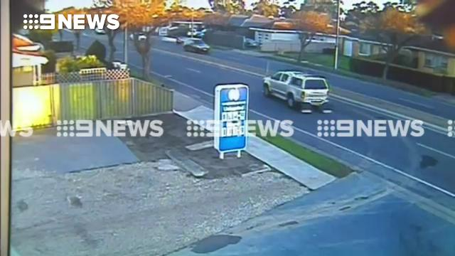 Police motorbike crashes into ute on busy road