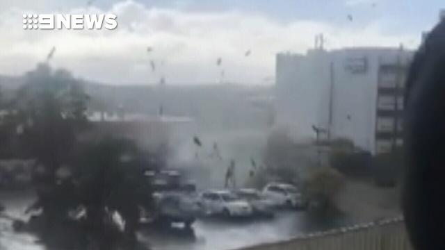 Powerful waterspout knocks down brick walls in Perth carpark