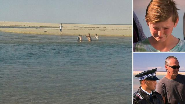 Police officer and dad swim out to save boy caught in dangerous rip