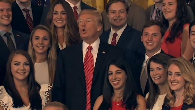 9RAW: Trump scolds press during intern photo-op