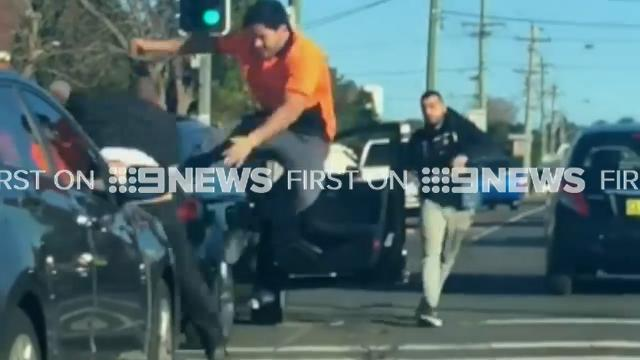 Ugly road rage brawl erupts on busy Sydney road