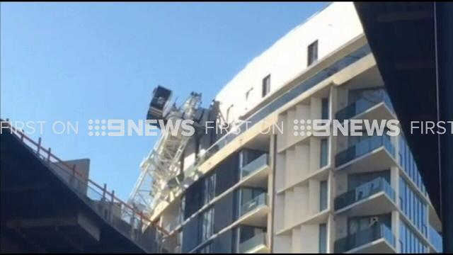 Two injured as crane crashes into Sydney apartment block
