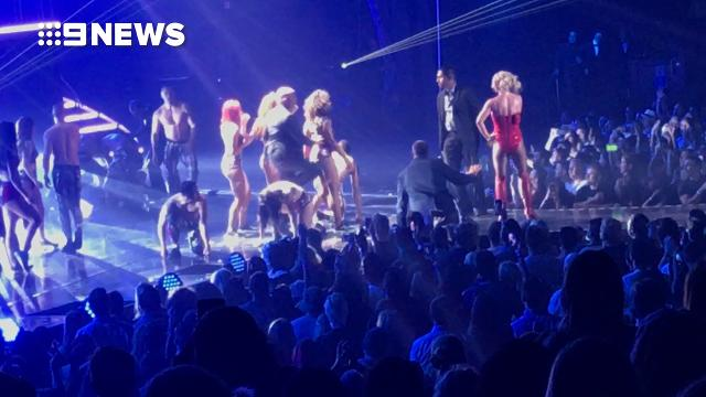 Fan jumps the stage at Britney Spears concert