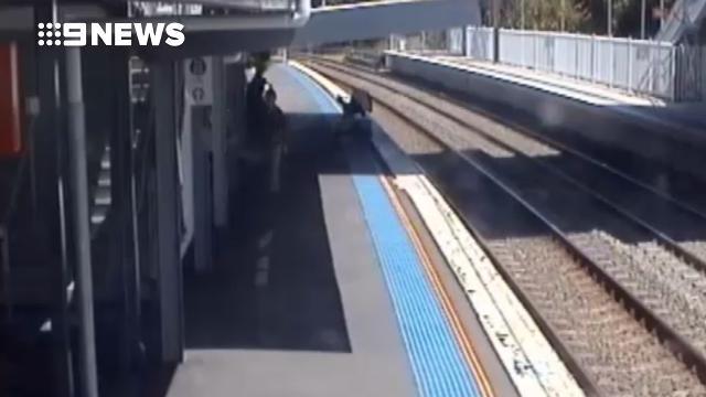 Heart-stopping moment pram rolls onto train tracks