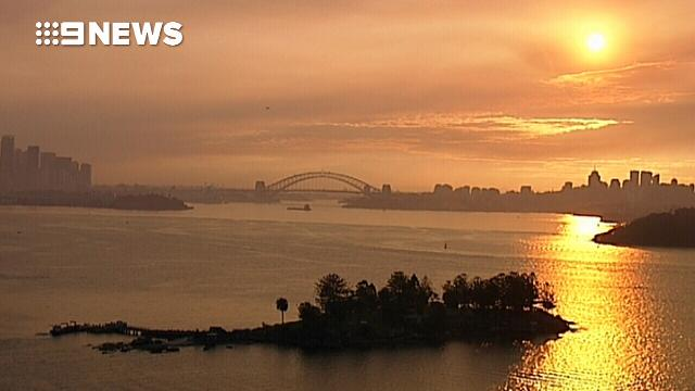 Sun goes down over a smoke-covered Sydney Harbour
