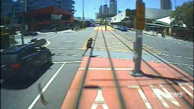 CCTV shows close calls with Queensland trams