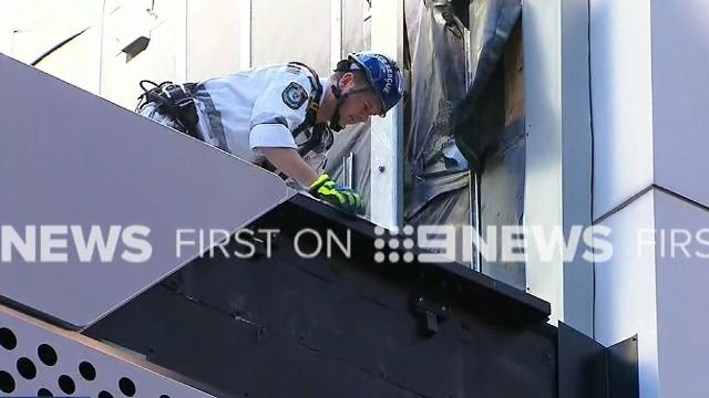 Two injured after strong winds tear panel off building in Sydney's CBD