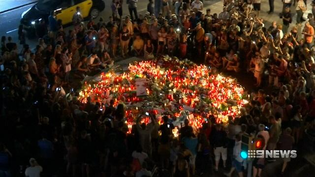 Thousands turn out to remember those killed in Spain terror attacks