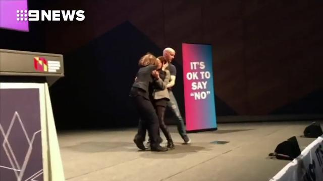 Same-sex marriage supporters stage kiss protest at 'No' rally