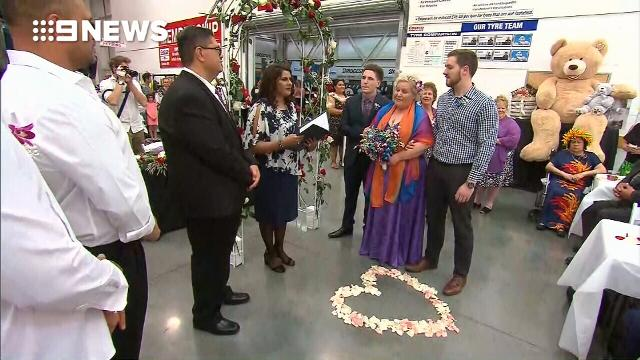 Blushing bride walks down the tyre aisle for dream Costco wedding
